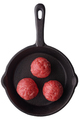 Three uncooked meatballs on a frying pan - PhotoDune Item for Sale