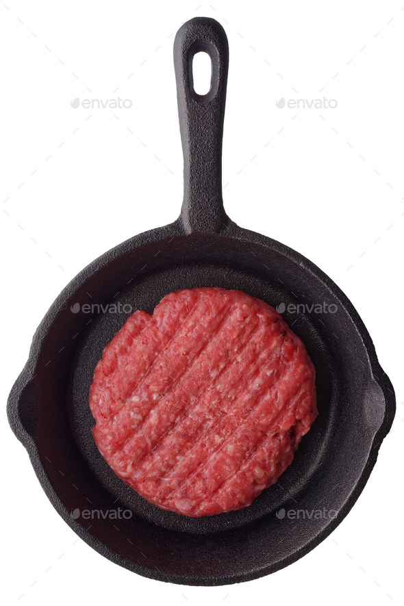 Uncooked burger on a frying pan - Stock Photo - Images