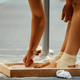 female gymnast rubs chalk on his legs - PhotoDune Item for Sale