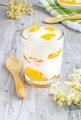 A fresh orange yogurt dessert in a glass - PhotoDune Item for Sale