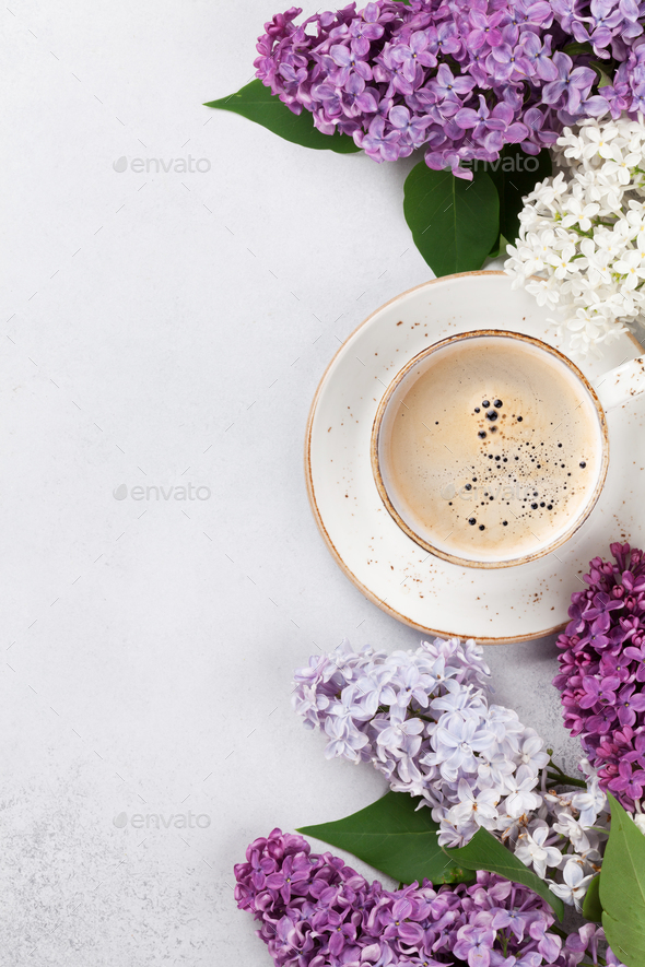 Colorful lilac flowers and coffee cup - Stock Photo - Images