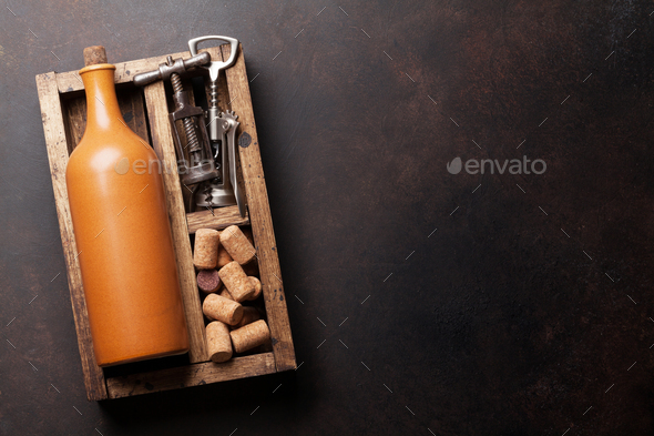 Wine bottle, corkscrew and corks - Stock Photo - Images