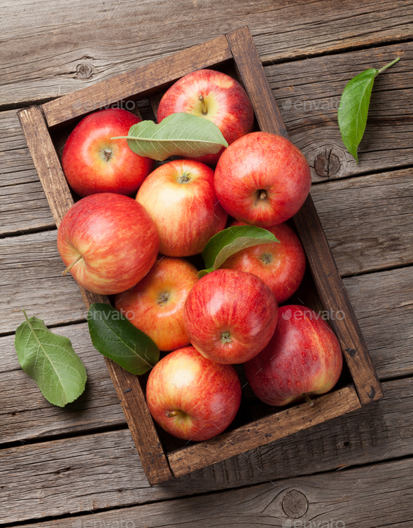Red apples in wooden box - Stock Photo - Images