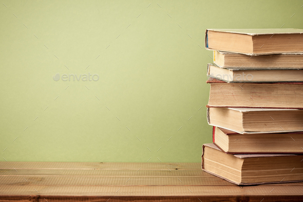Stack of old books on wooden table - Stock Photo - Images