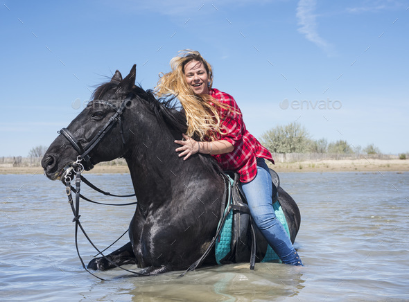 riding woman on the beach - Stock Photo - Images