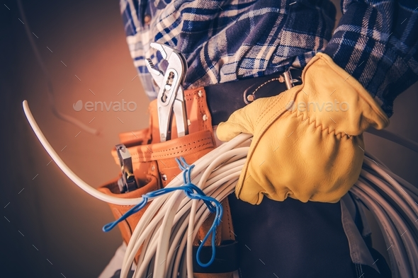 Electrician with Electric Cable - Stock Photo - Images