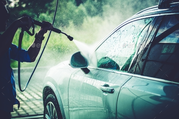 Men Cleaning His Vehicle - Stock Photo - Images