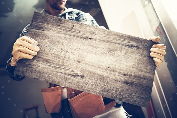 Contractor with Ceramic Tile - Stock Photo - Images