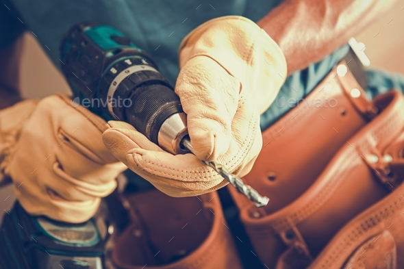 Contractor with Power Tool - Stock Photo - Images