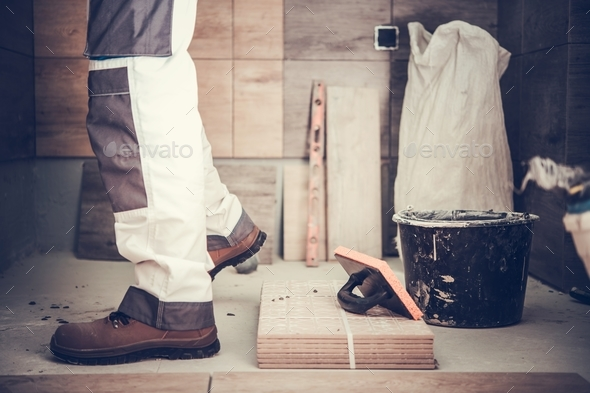 Worker Remodeling Bathroom - Stock Photo - Images