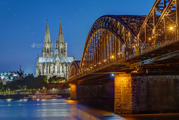 The Cologne Cathedral and the Hohenzollern railway bridge - Stock Photo - Images