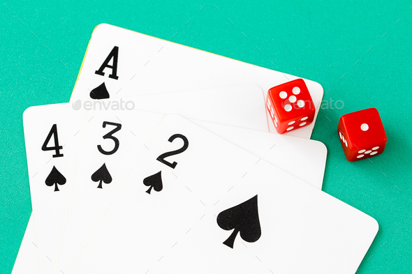Dices and cards on green casino table-12 - Stock Photo - Images
