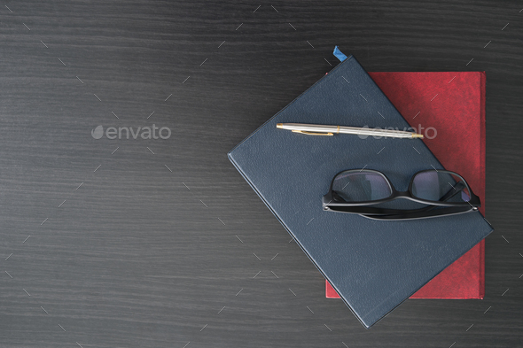 Glasses and book on the wood desk-3 - Stock Photo - Images