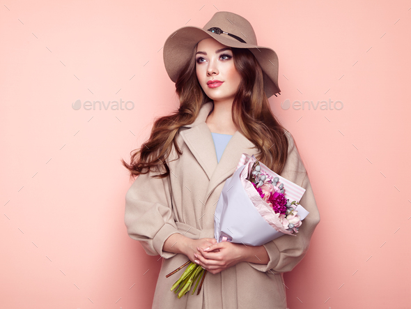 Brunette young woman in stylish greatcoat - Stock Photo - Images