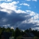 Clouds Float Above the Forest and Houses. - VideoHive Item for Sale