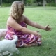 Young Woman Playing with Puppies of Golden Retriever in Park - VideoHive Item for Sale
