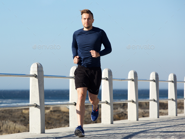healthy young man going for a run outside - Stock Photo - Images