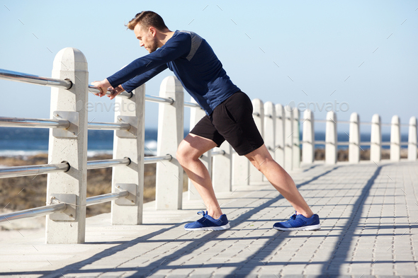 healthy young man stretching outside for exercise - Stock Photo - Images