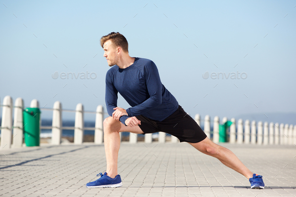 healthy young man stretching exercise outdoors - Stock Photo - Images