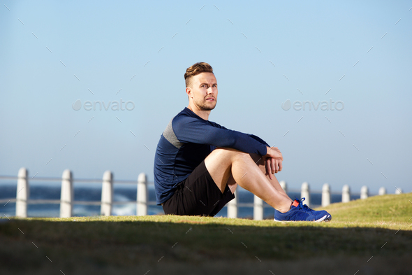 young sports man sitting outside after workout - Stock Photo - Images