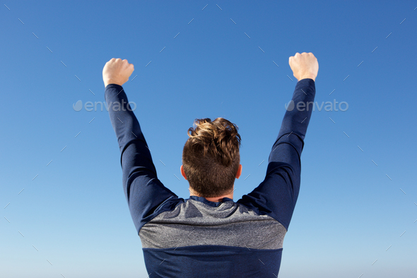 behind of man with harsh raised in the air - Stock Photo - Images