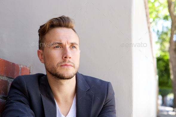 handsome young businessman looking away - Stock Photo - Images