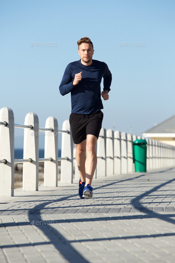 active young man running outside - Stock Photo - Images