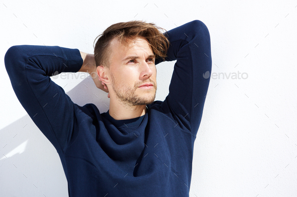 cool fashion guy looking away with hands behind head - Stock Photo - Images