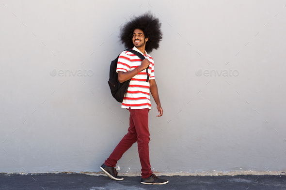happy college student with bag walking - Stock Photo - Images
