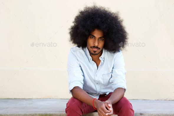 serious young man with afro - Stock Photo - Images