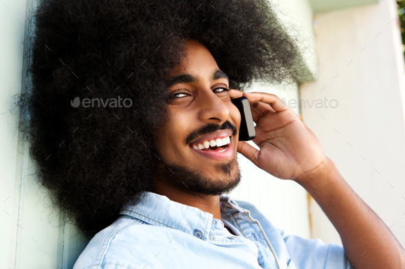 happy afro man talking on mobile phone and smiling - Stock Photo - Images