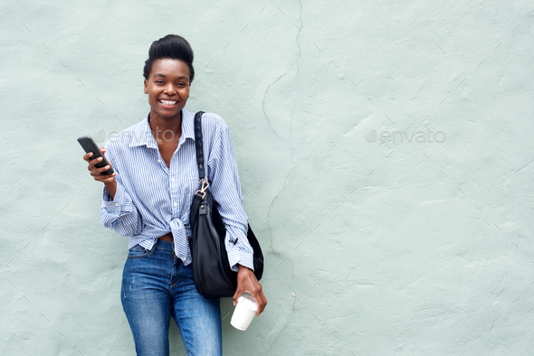 beautiful black woman holding cellphone - Stock Photo - Images