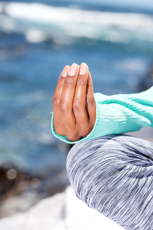 female hands in yoga position at the beach - Stock Photo - Images
