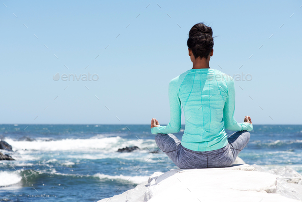 behind of yoga woman at the beach - Stock Photo - Images