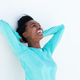 young black woman laughing with hands behind head - PhotoDune Item for Sale
