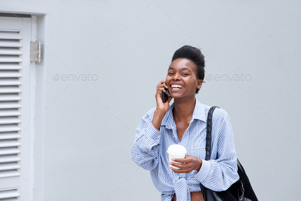 cool young black woman talking on cell phone - Stock Photo - Images