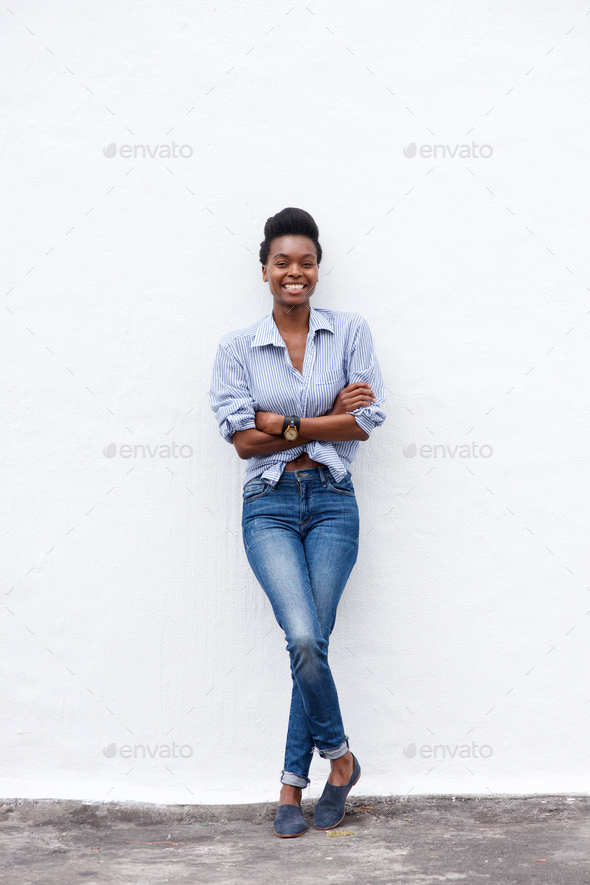african american woman smiling against white wall - Stock Photo - Images