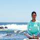 young african american woman doing yoga at the beach - PhotoDune Item for Sale
