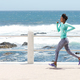 young african american woman running by the sea - PhotoDune Item for Sale