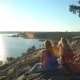 Happy Female Couple Drinking Champagne on a High Rock in the Sunshine - VideoHive Item for Sale