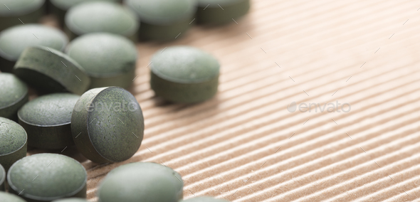 Pure Organic Spirulina Tablets with Copy Space - Stock Photo - Images