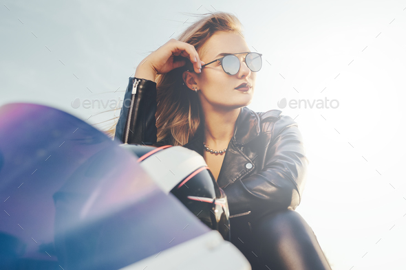 Close-up portrait young beautiful biker in fashionable sunglasse - Stock Photo - Images