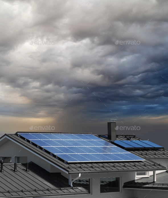 Solar panels on house rooftop - Stock Photo - Images
