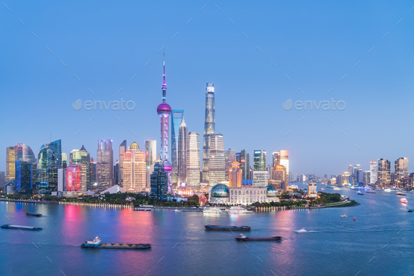shanghai skyline in nightfall of light and colour - Stock Photo - Images