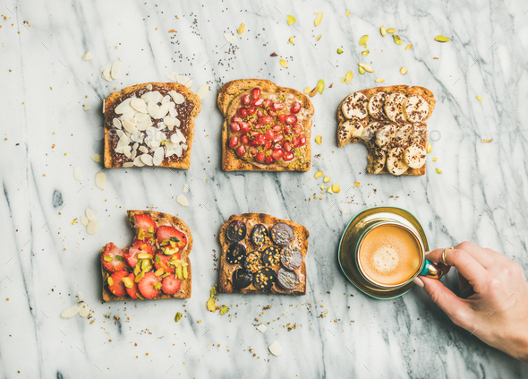 Healthy breakfast with wholegrain toasts , coffee over grey marble background - Stock Photo - Images