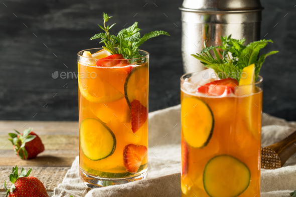 Sweet Refreshing Pimms Cup Cocktail with Fruit - Stock Photo - Images