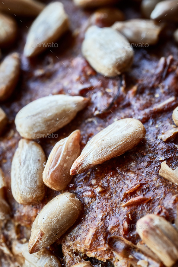 Whole wheat bread crust with sunflower seeds. - Stock Photo - Images