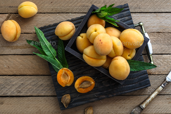 Apricots on wooden board, top view - Stock Photo - Images