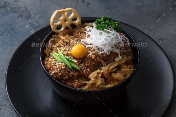 Rice bowl topped with fried pork cutlet Katsudon, tonkatsu donburi, japanese cuisine - Stock Photo - Images