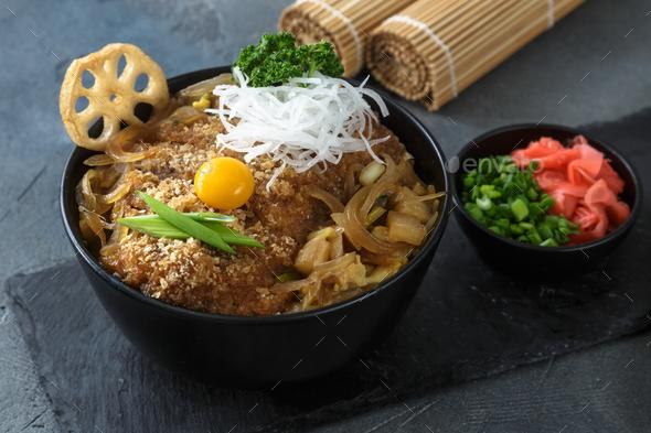 Rice bowl topped with fried pork cutlet Katsudon, tonkatsu donburi, japanese cuisine - Stock Photo - Images